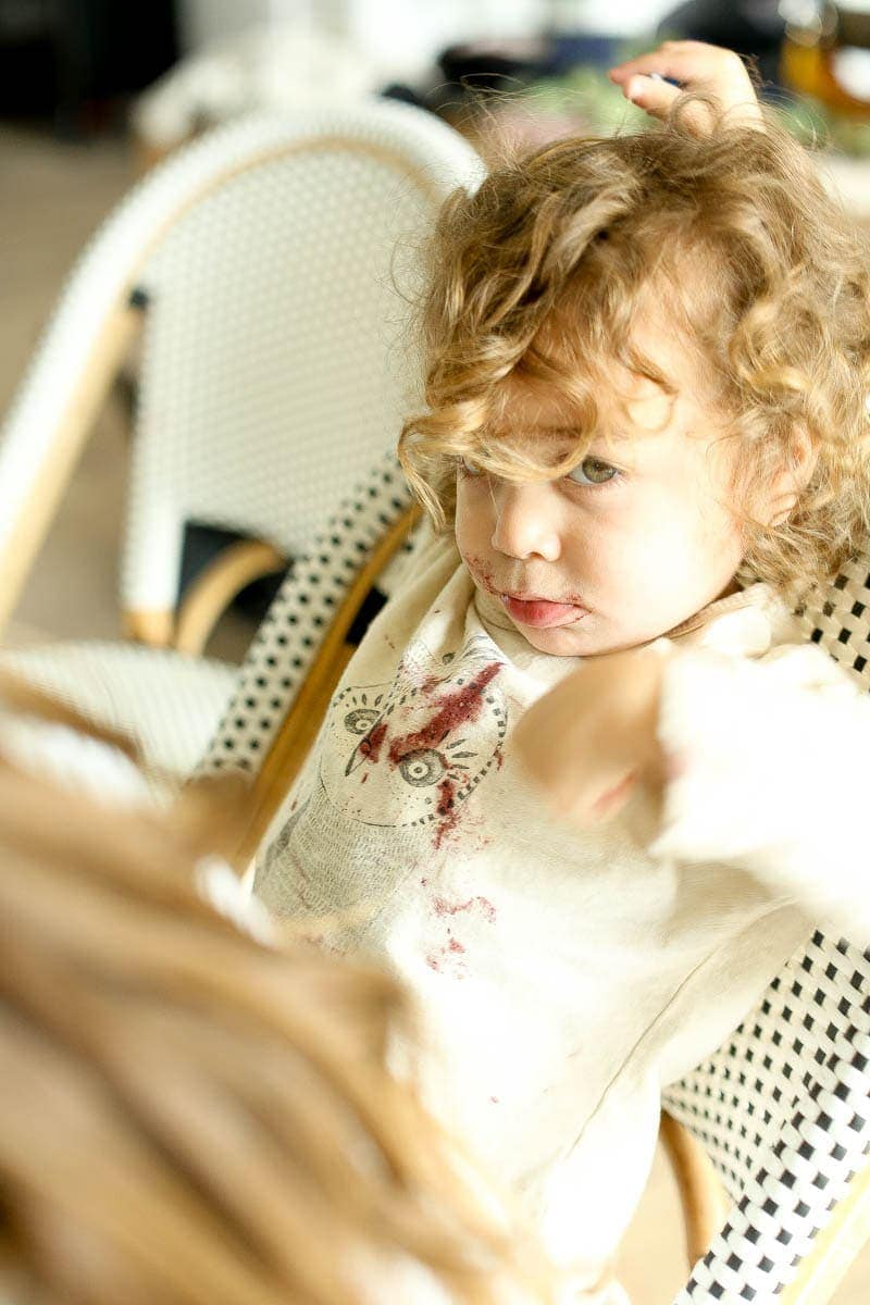 unhappy toddler sitting in chair