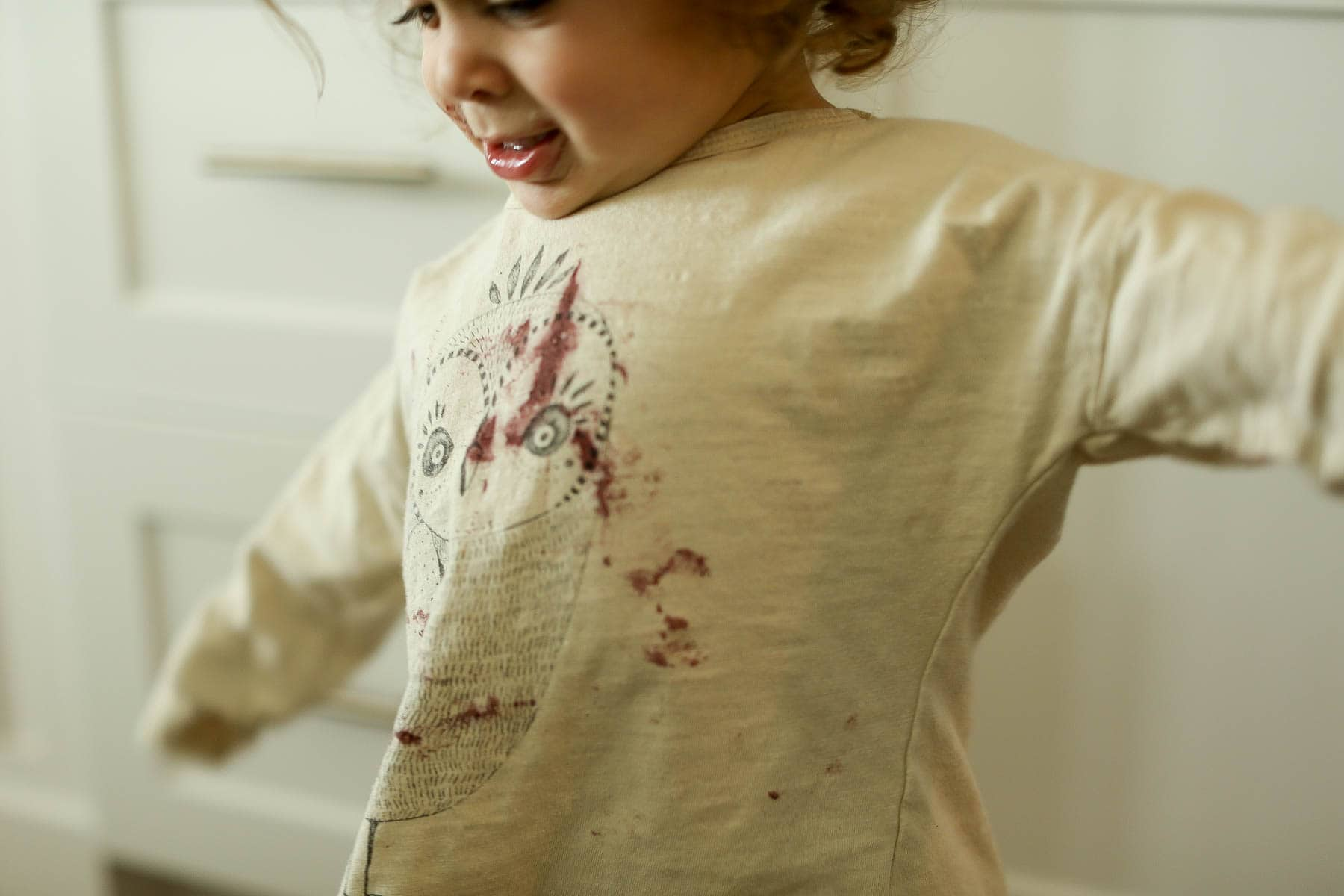 child in dirty shirt
