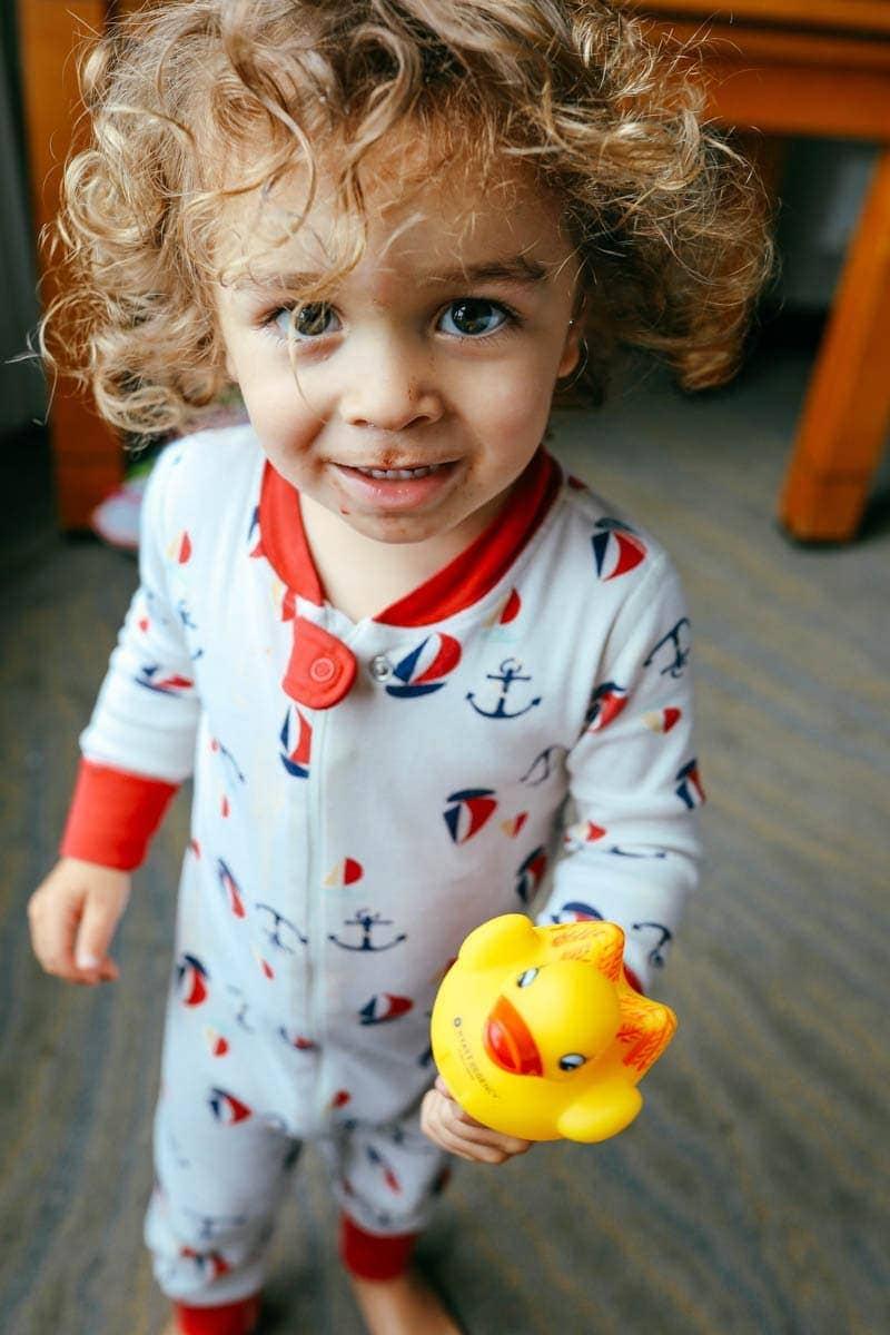 Boy Holding a Rubber Duck #citygirlgonemom #hyattregency #lajollasandiego #lajolla
