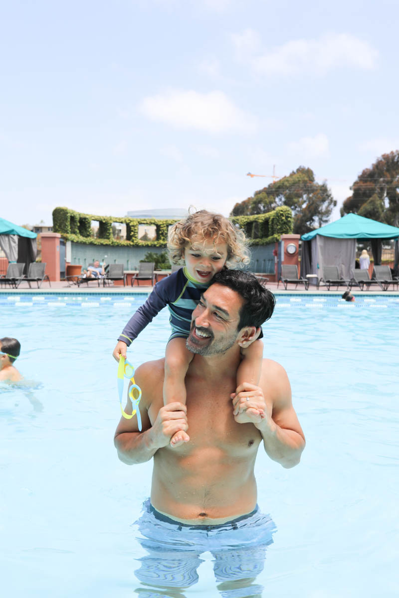 Dad and son enjoying pool #citygirlgonemom #hyattregency #lajollasandiego #lajolla