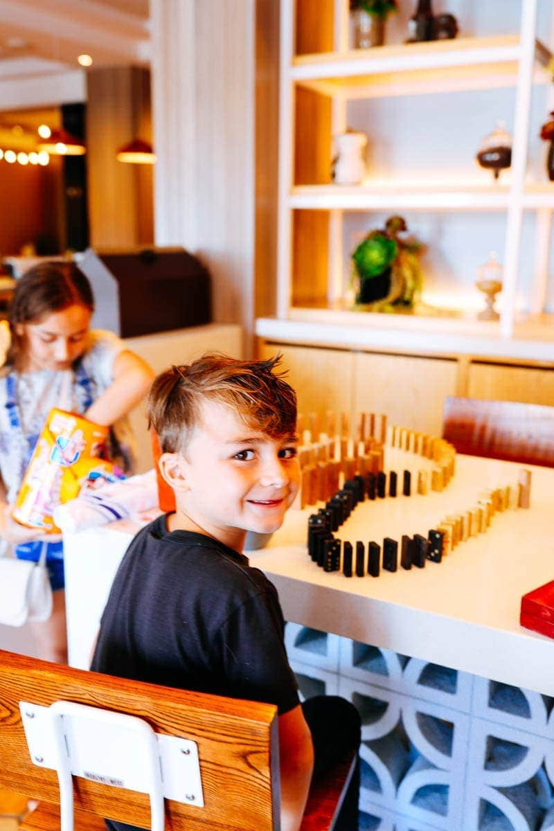 Happy Kids Playing Dominoes #citygirlgonemom #hyattregency #lajollasandiego #lajolla