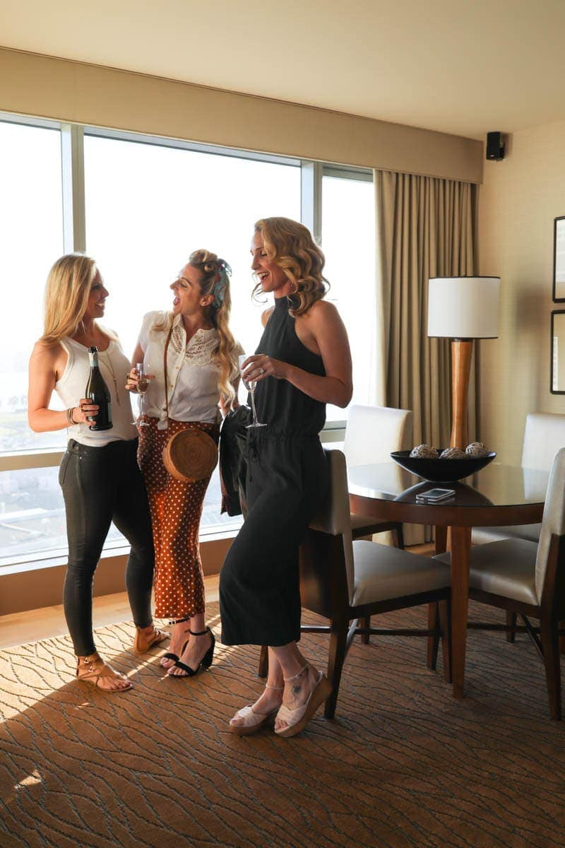Girls Chatting While Drinking Wine #citygirlgonemom #omnihotel #sandiego #datenight