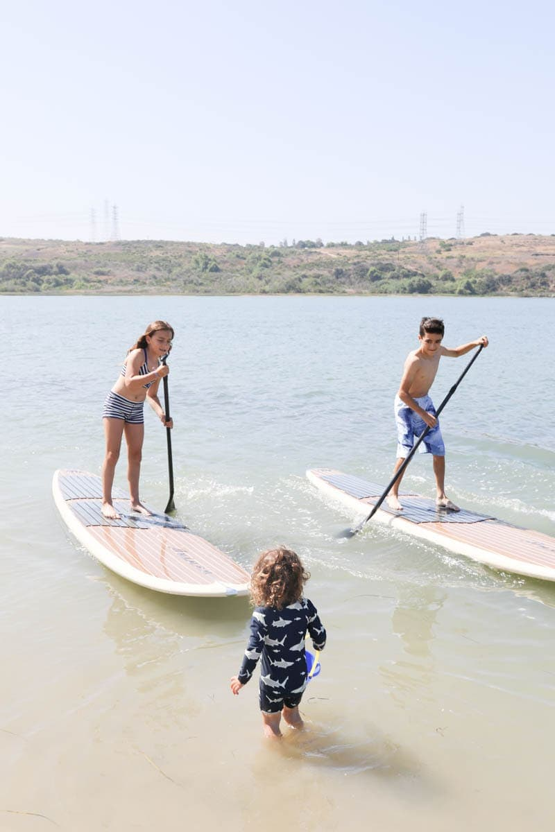 Kids Standing Up on Paddle Boards #familytravelsandiego #sandiego #fourseasonsresidenceclub #bigfamilytravel