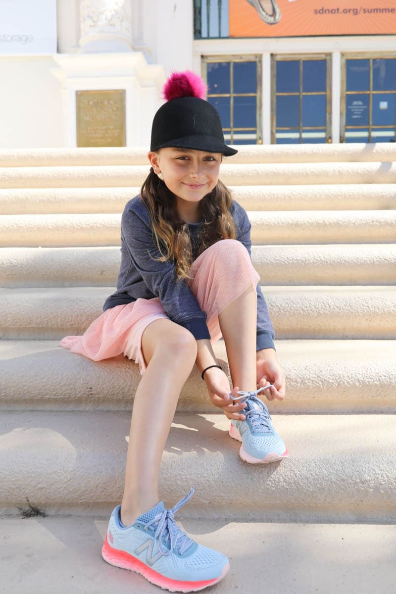 girl on steps in sneakers