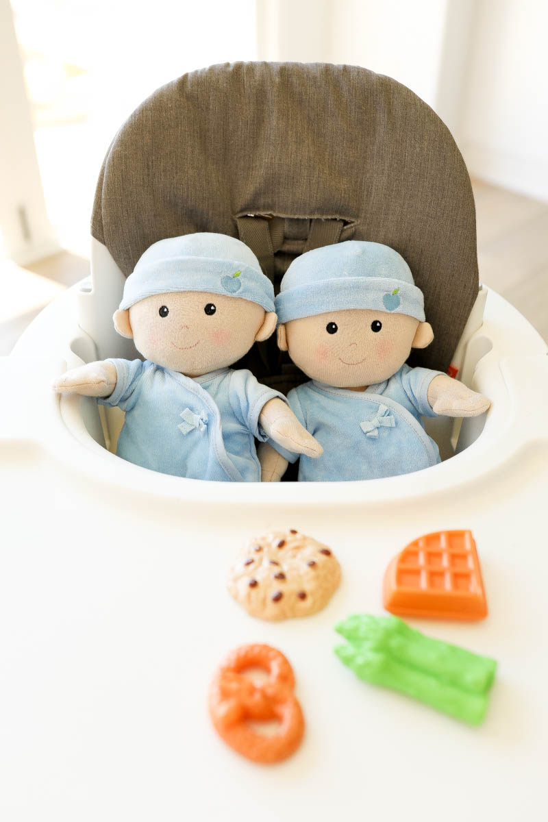 Cute Baby Dolls in a high chair