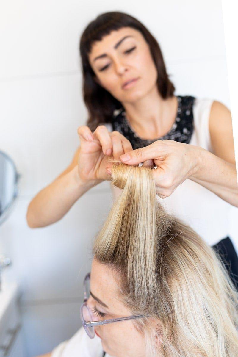 Step 4: Hair Stylist Rolling the Hair around the Fingers #pinuptutorial #vintagehairstyle #hairstyle #citygirlgonemom #hairstyle #hairstyling #vintagewaves #vintagelook #hair