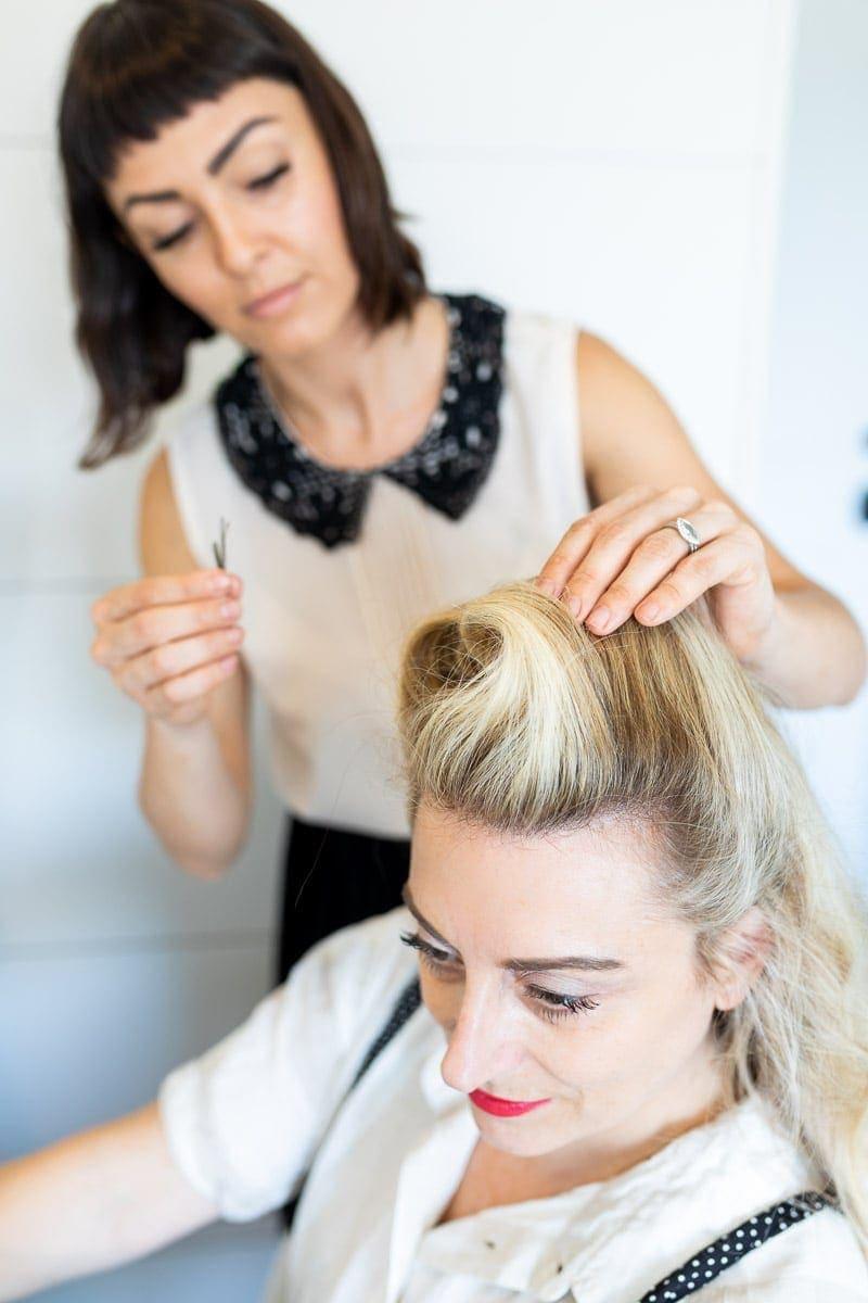 Step 5: Hair Stylist Prepairing to secure the hair with Bobby Pins #pinuptutorial #vintagehairstyle #hairstyle #citygirlgonemom #hairstyle #hairstyling #vintagewaves #vintagelook #hair