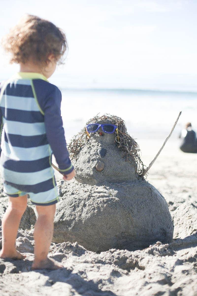 Kid playing with sand #kids #summertips #summerparentingtips #citygirlgonemom
