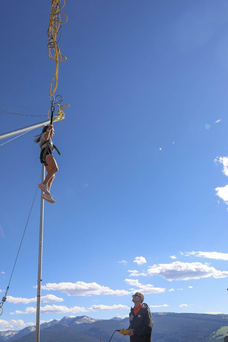 Girl Kid enjoying the Bungee trampoline #summer #vailcolorado #vacation #citygirlgonemom