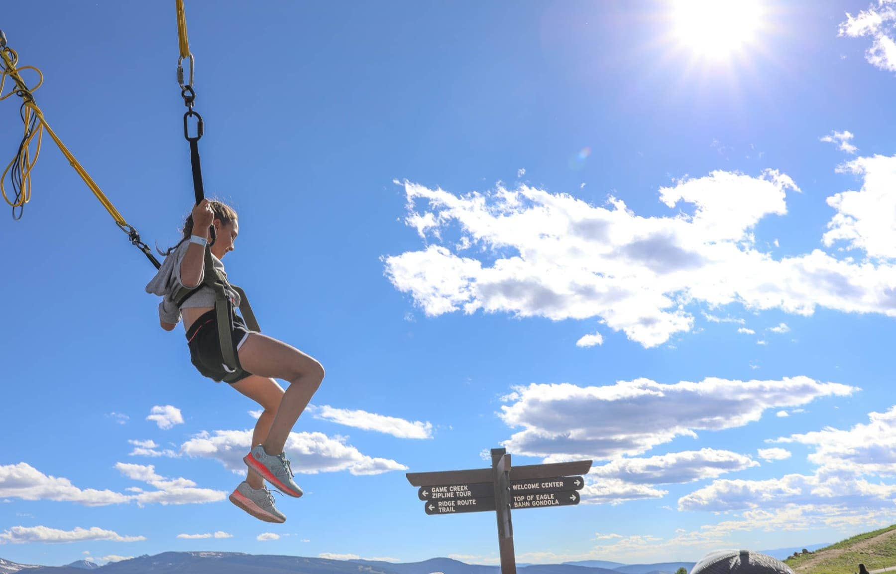 Happy Child Bounces on A Bungee Trampoline #summer #vailcolorado #vacation #citygirlgonemom