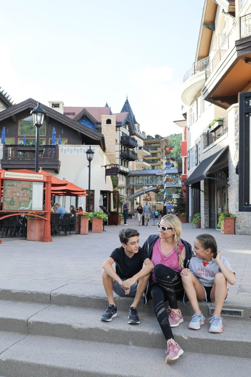 Happy mother with two children sitting on the floor with country house background spending time together summer #vailcolorado #vacation #citygirlgonemom