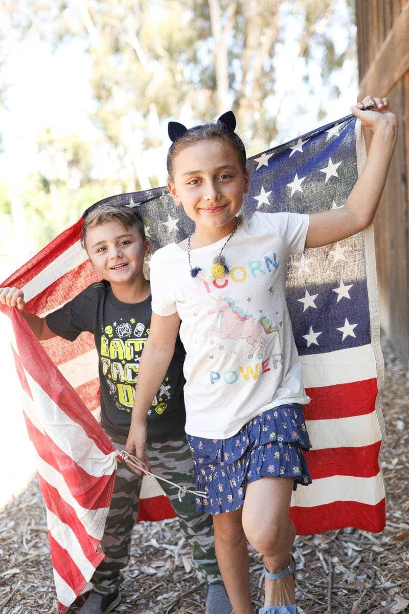 kids with flag back to school