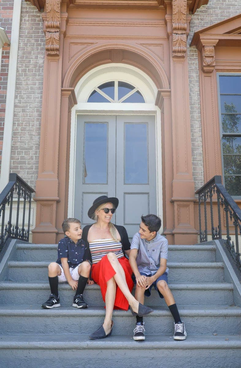 Happy Mom Sitting on the Stairs with her Kids #hollywood #warnerbrothers #teentitansgotothemovies #citygirlgonemom