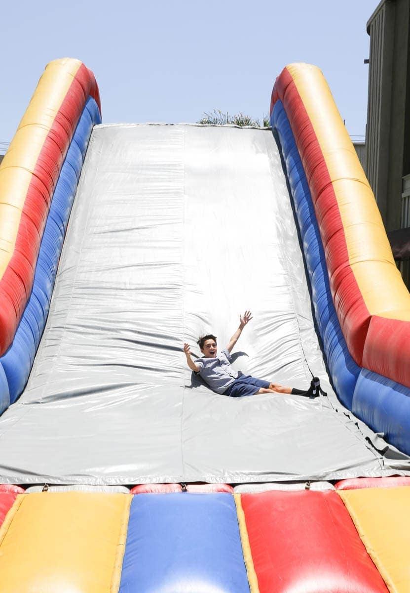 Kid Enjoying the Inflatable Slide at Warner Bros Studios #hollywood #warnerbrothers #teentitansgotothemovies #citygirlgonemom