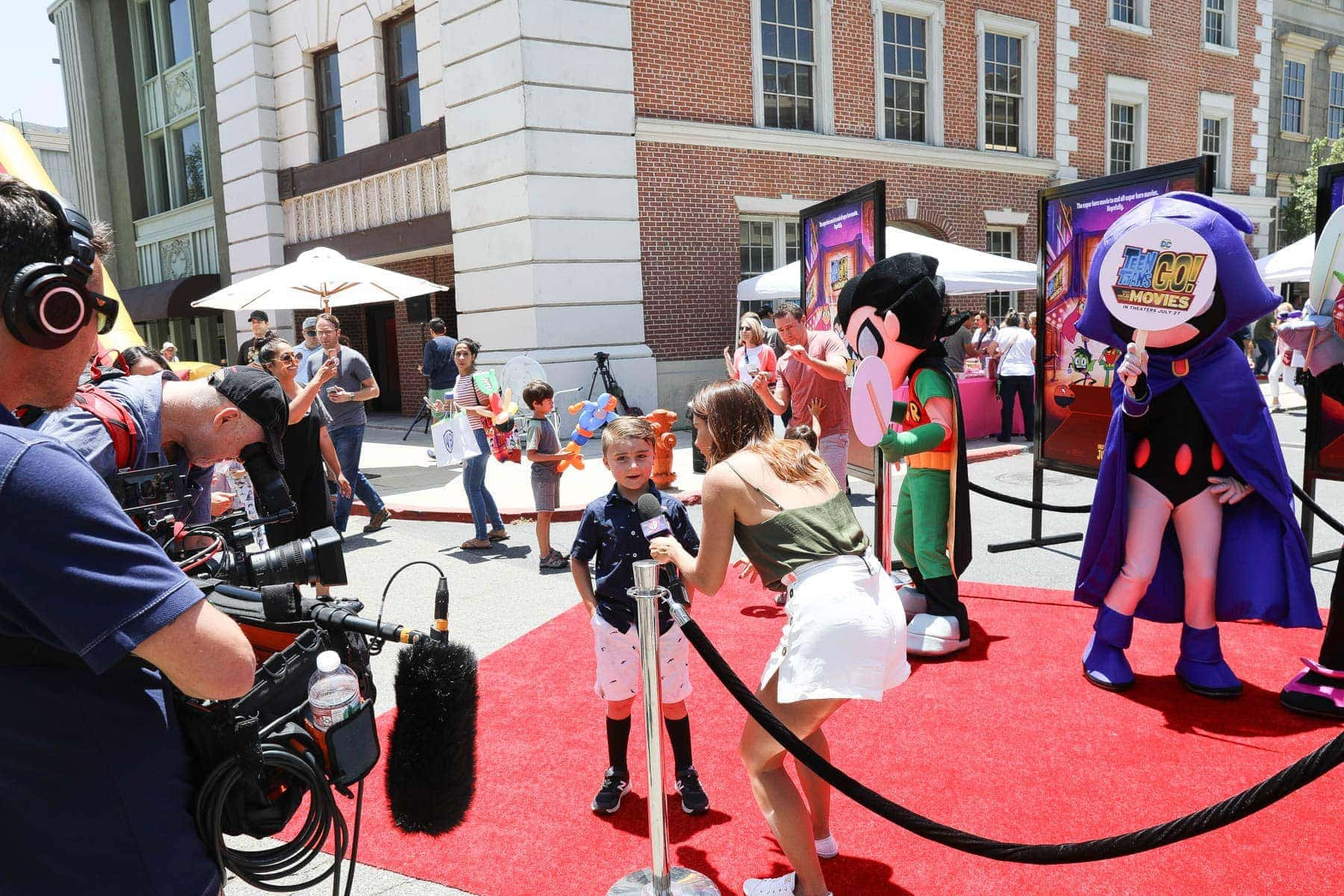 Lady Interviewing a Boy with Cameramen and Mascots #hollywood #warnerbrothers #teentitansgotothemovies #citygirlgonemom