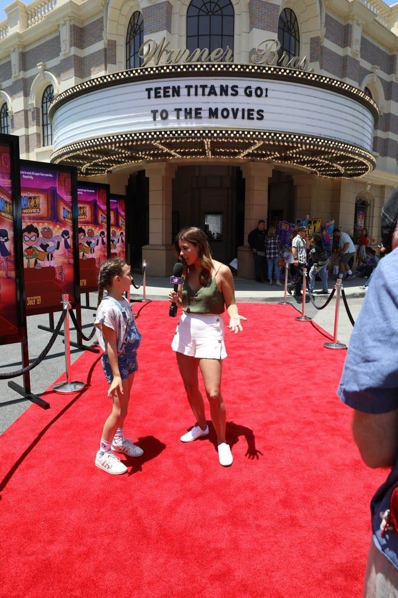 Lady Interviewing A Kid outside the Warner Bros Studios #hollywood #warnerbrothers #teentitansgotothemovies #citygirlgonemom