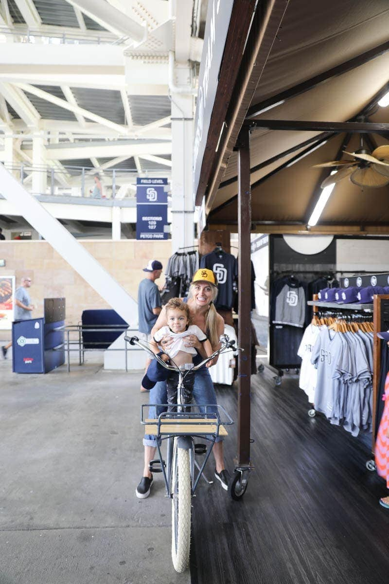 Mom and Child riding a Bike in the Team Store #familyday #weekend #familydaysout #citygirlgonemom #teamstore