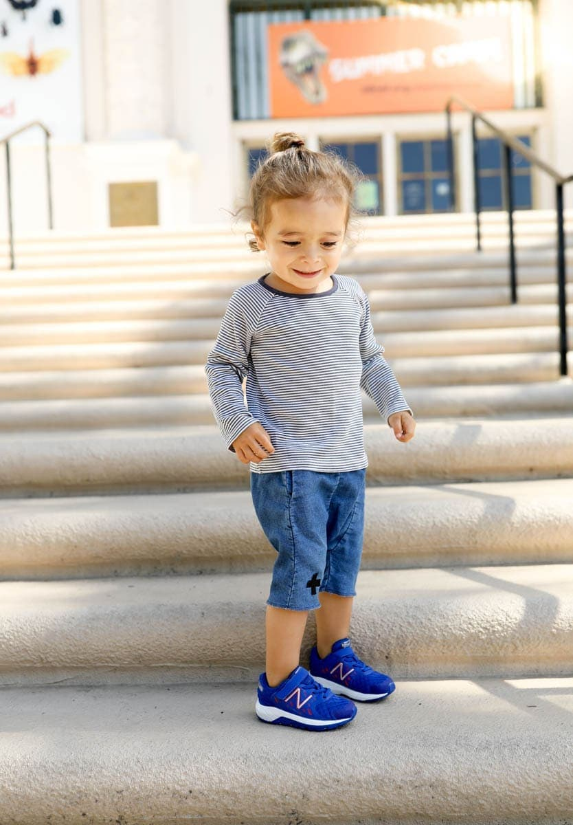 toddler on steps in new balance