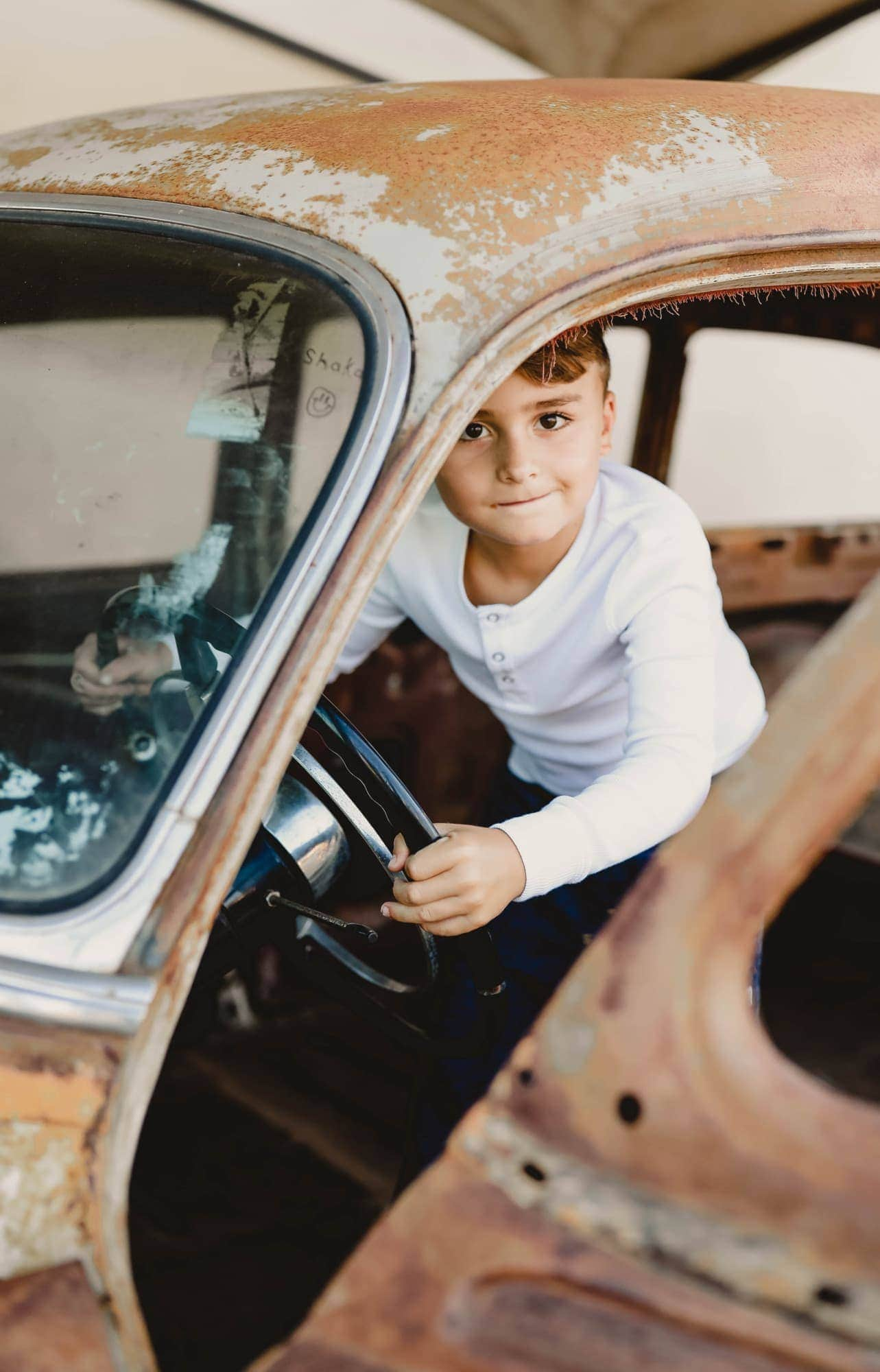 boy in vintage car