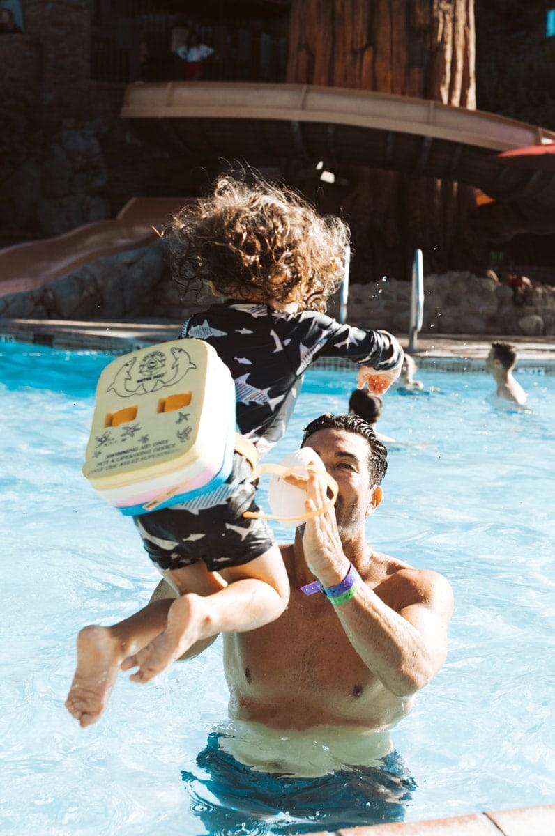 Toddler Jumping In Pool