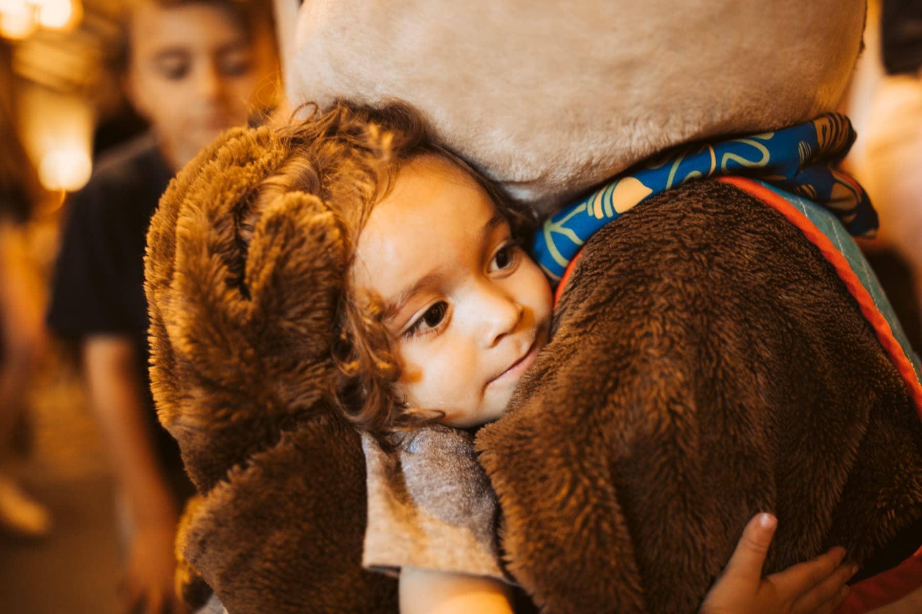 toddler hugging character