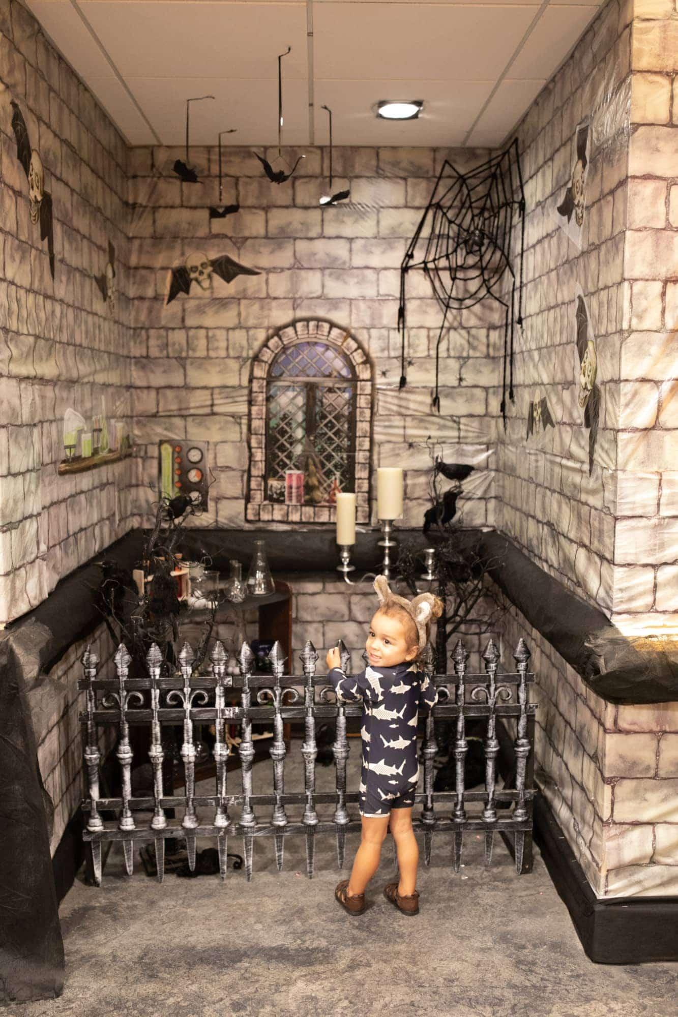 toddler in spooky hallway
