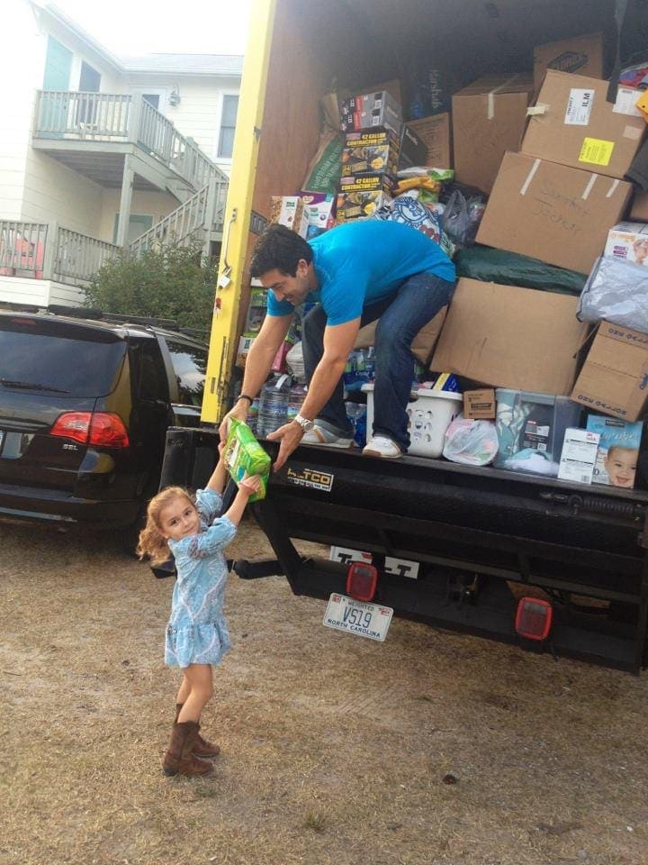 dad and daughter helping in hurricane
