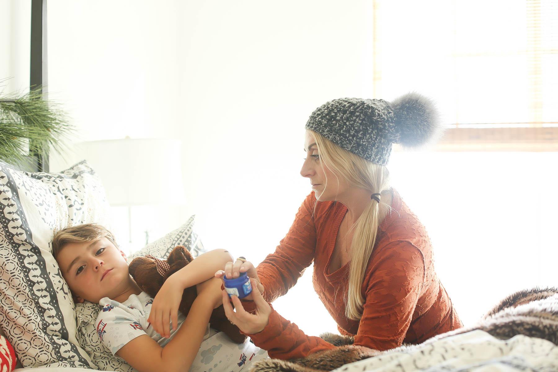 mom helping sick kid