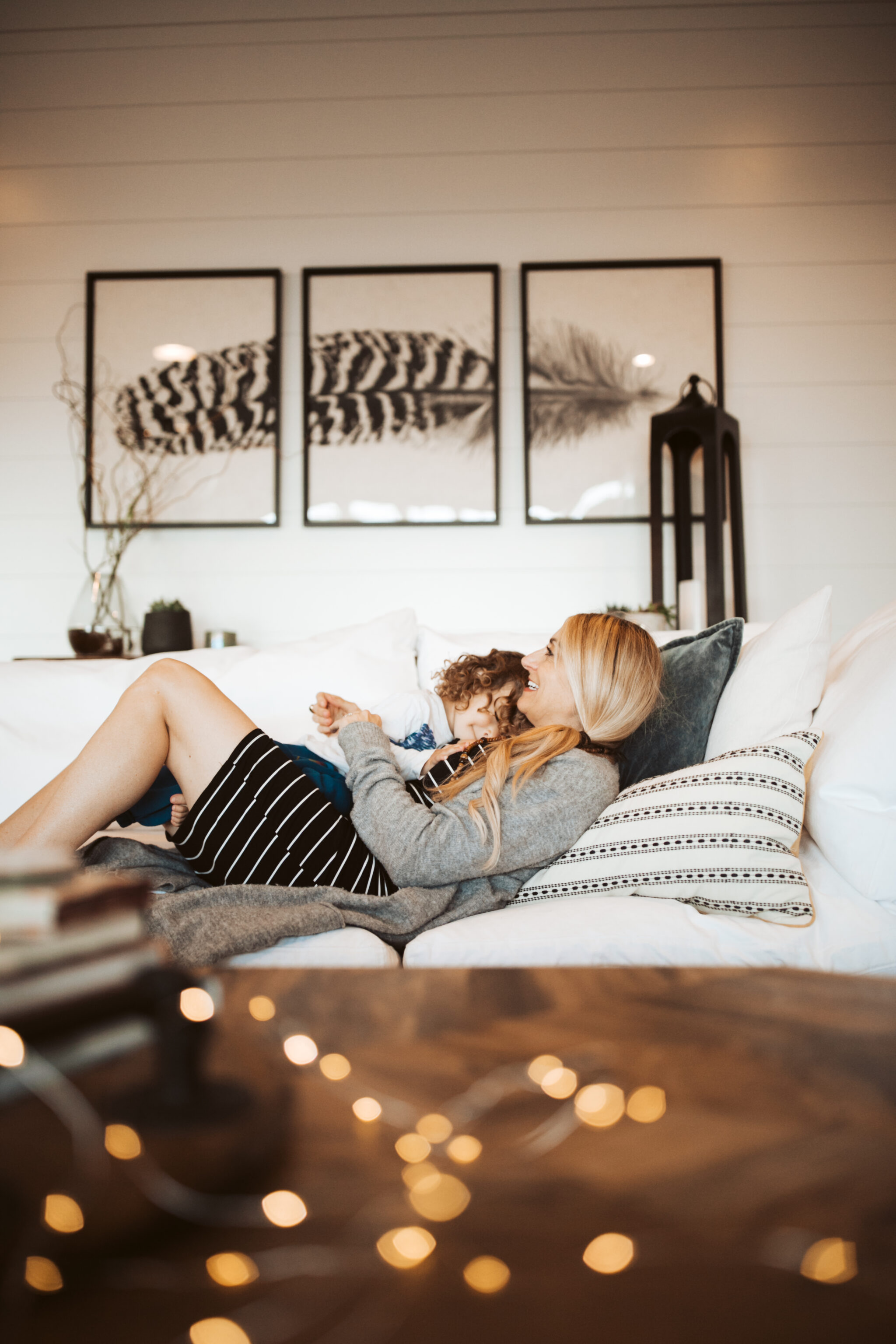 mother and toddler on couch
