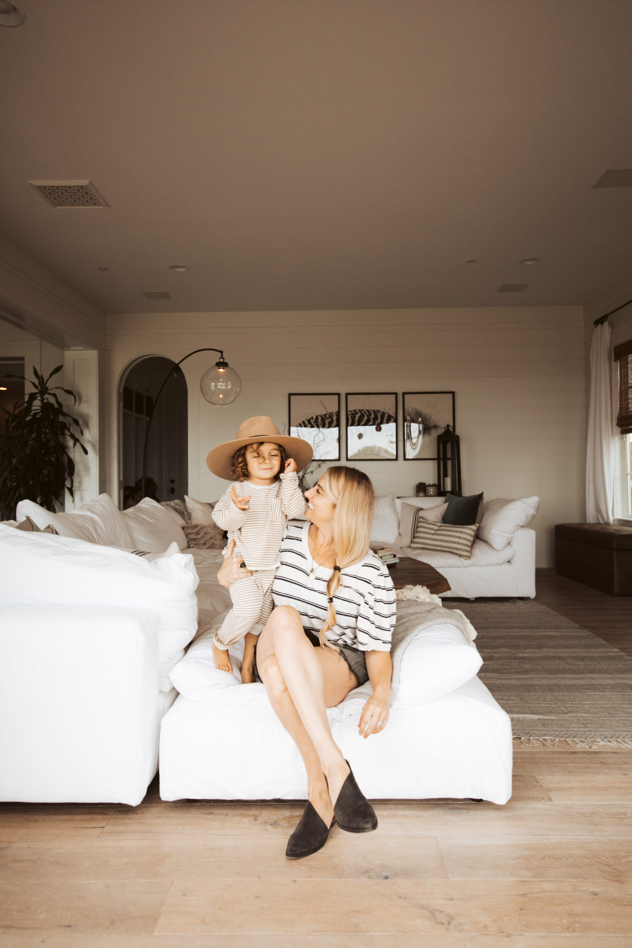 mom and kid sitting on couch