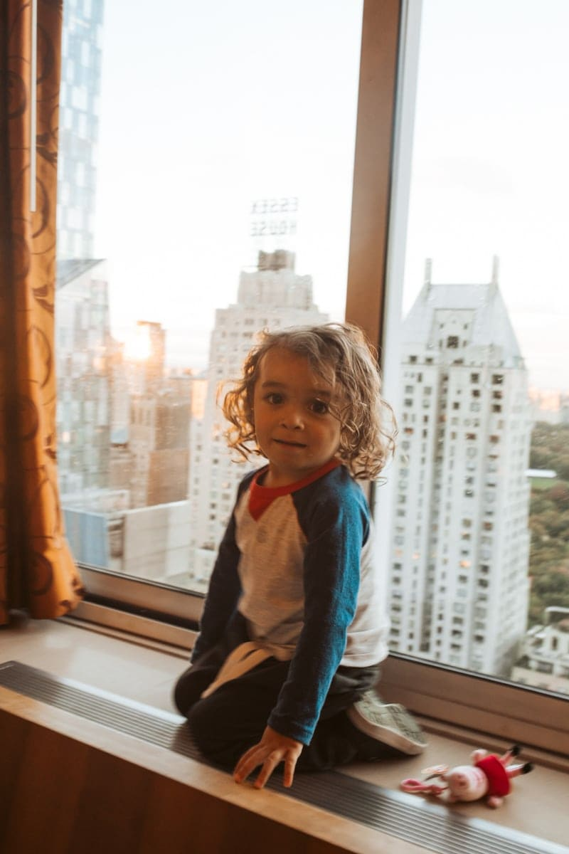 toddler in NYC window