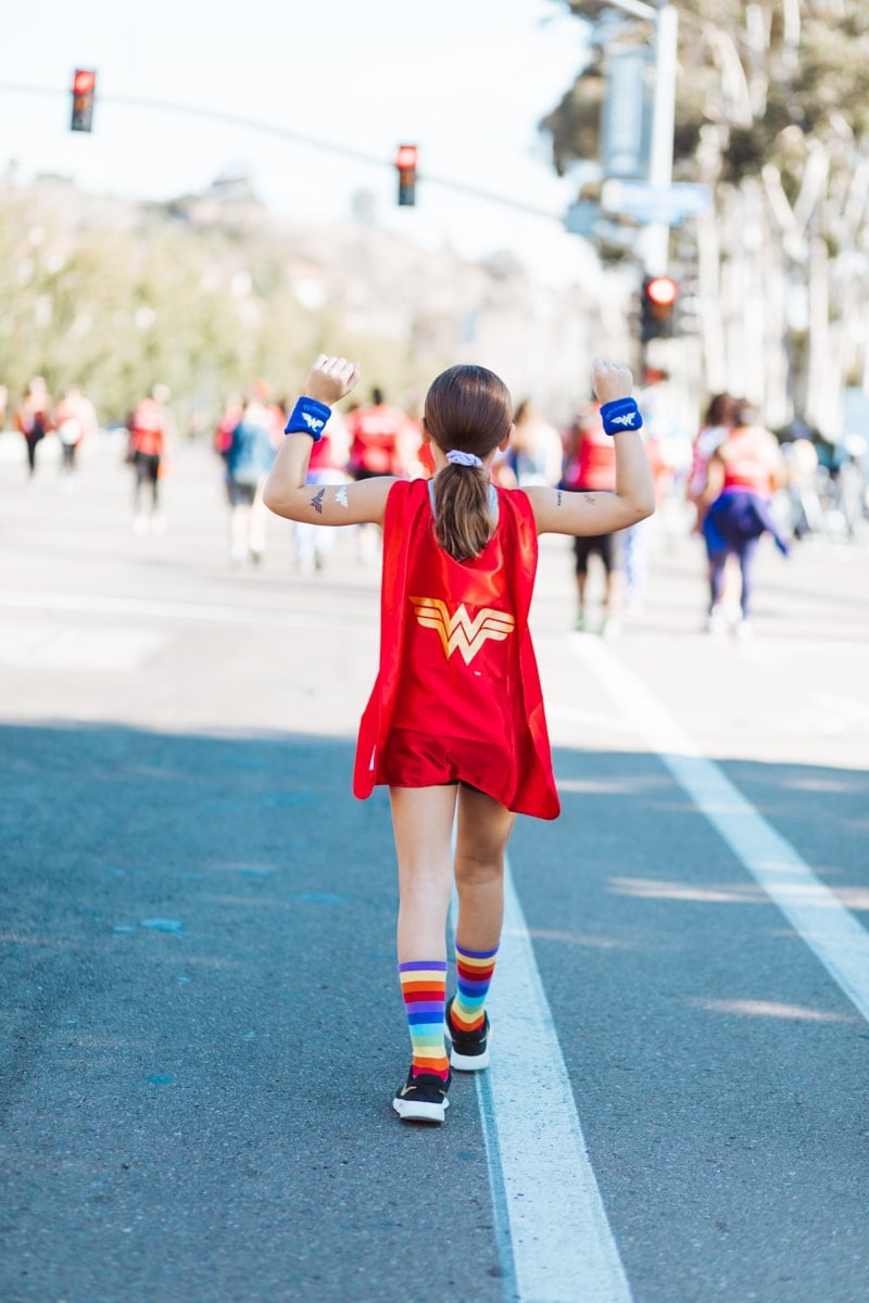 young girl running Wonder Woman race