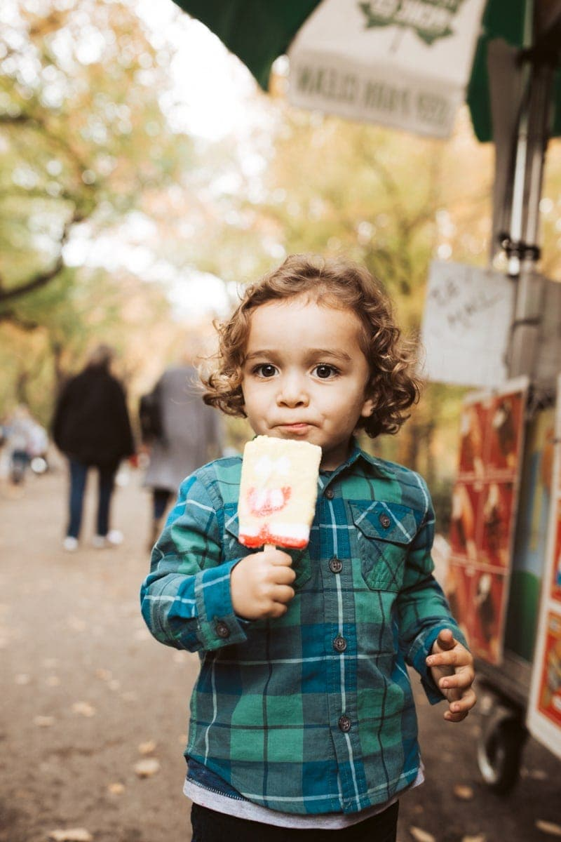 boy eating popsicle