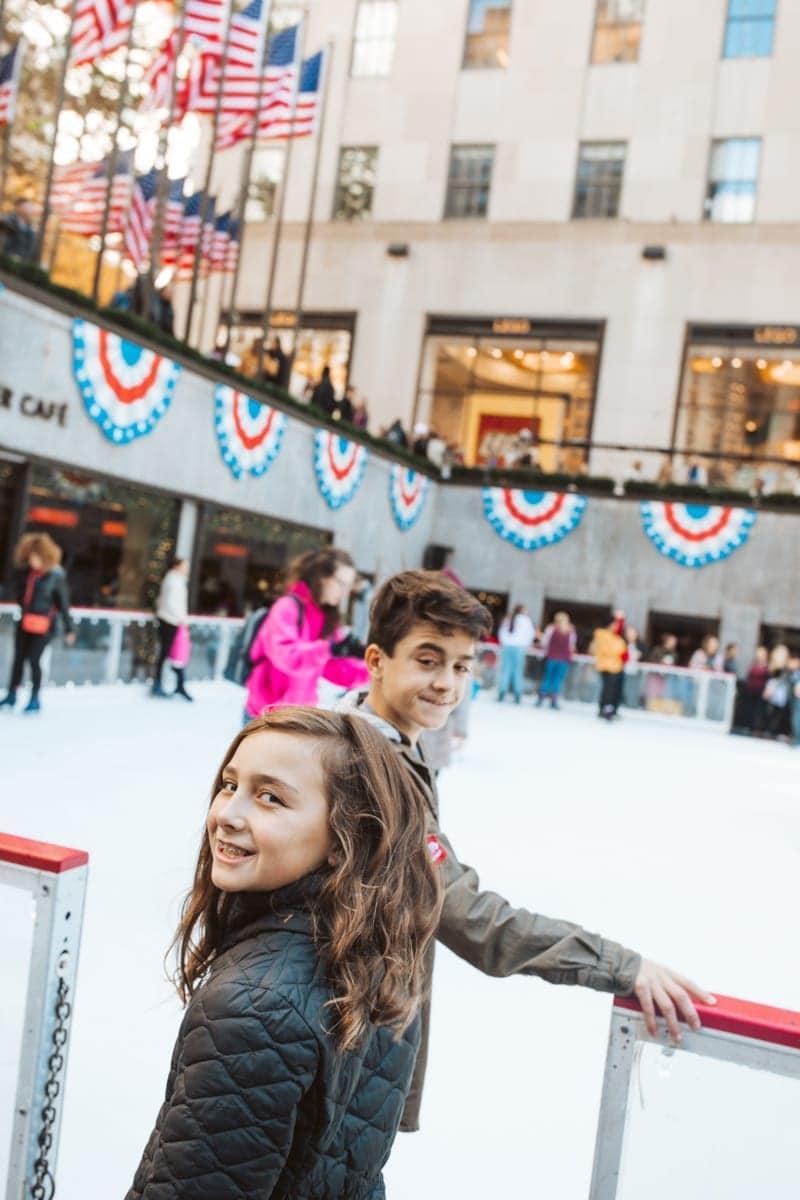 kids skating at rockefeller center