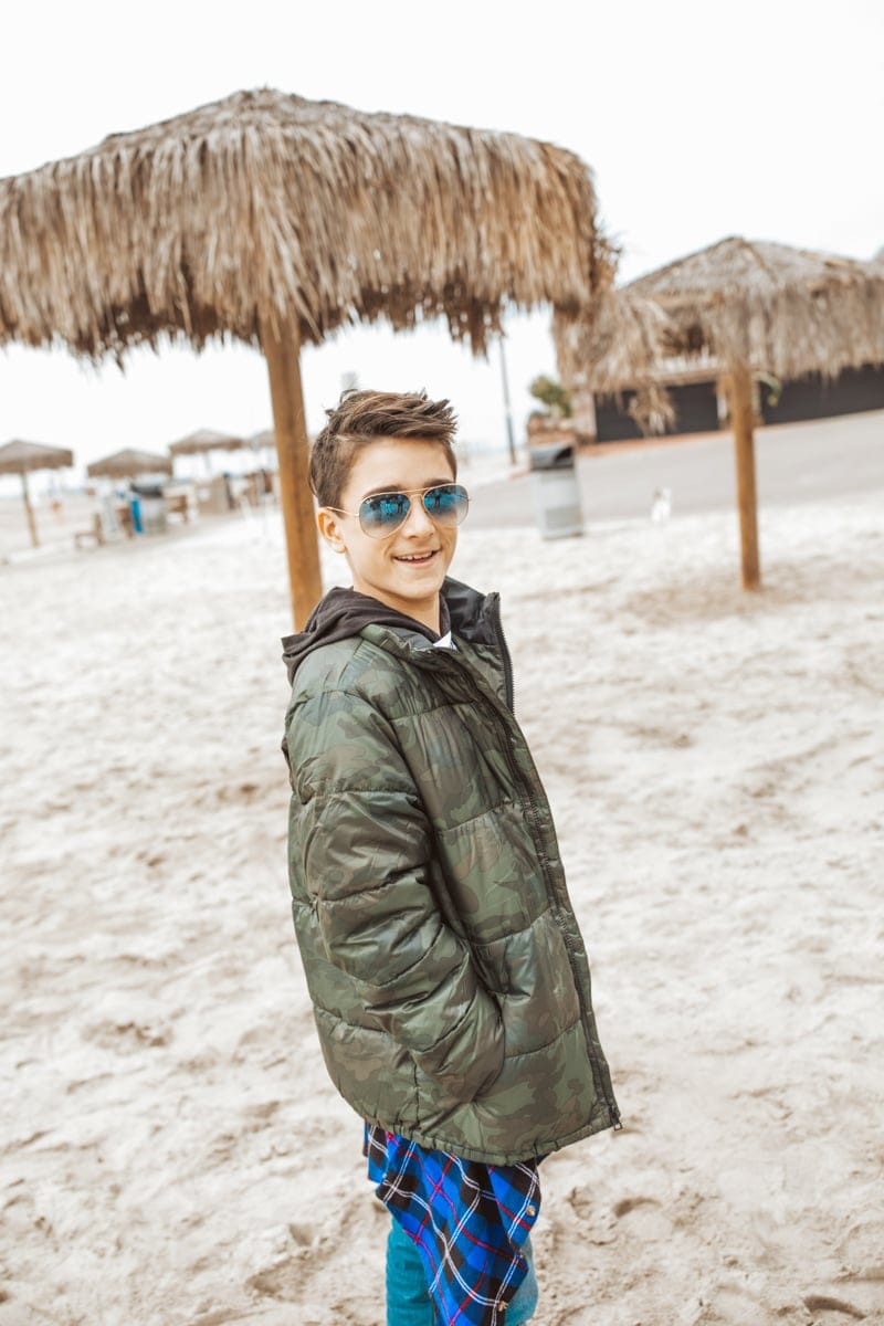 teen on the beach in sunglasses