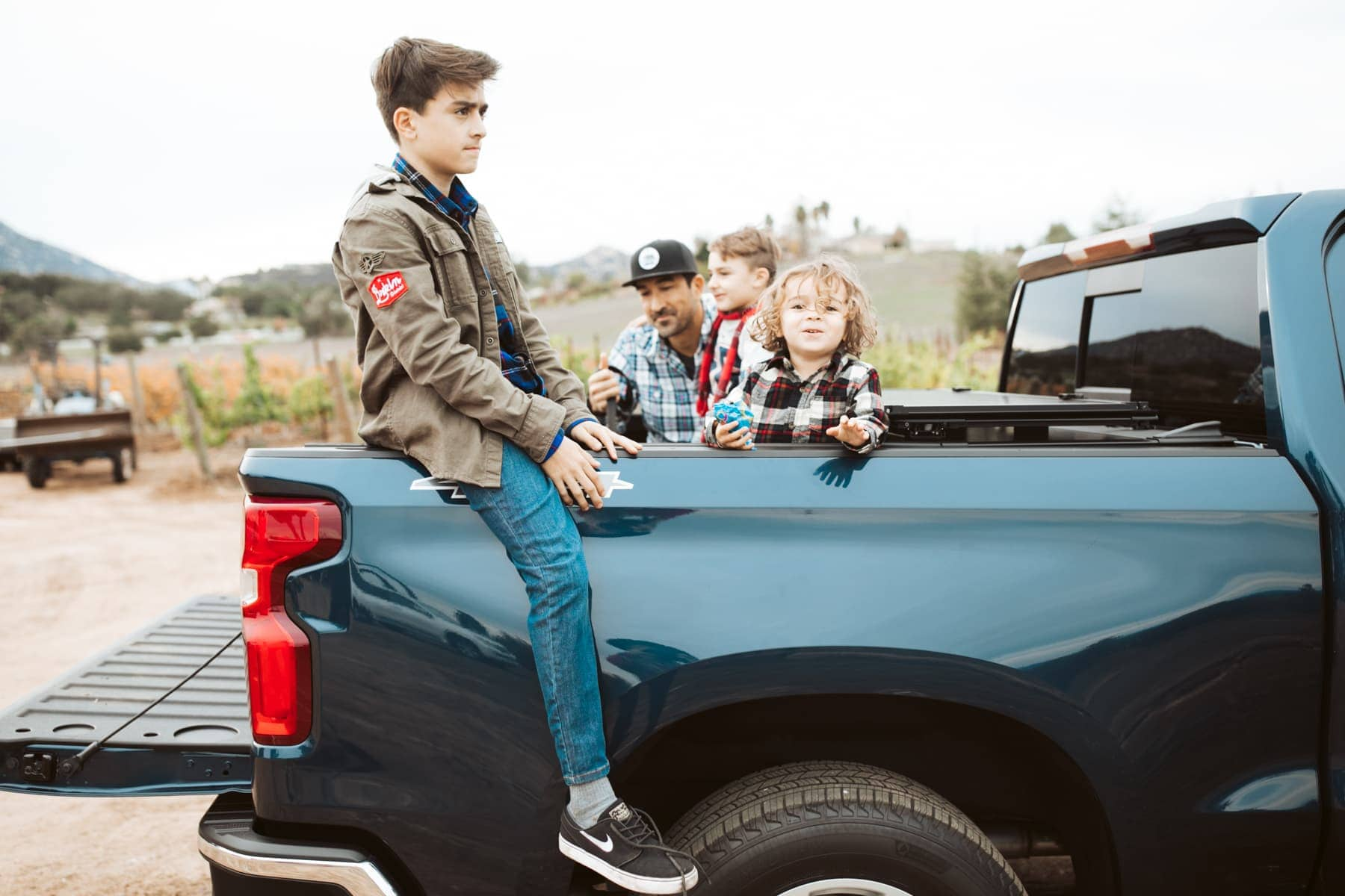 kids in the back of a pickup truck