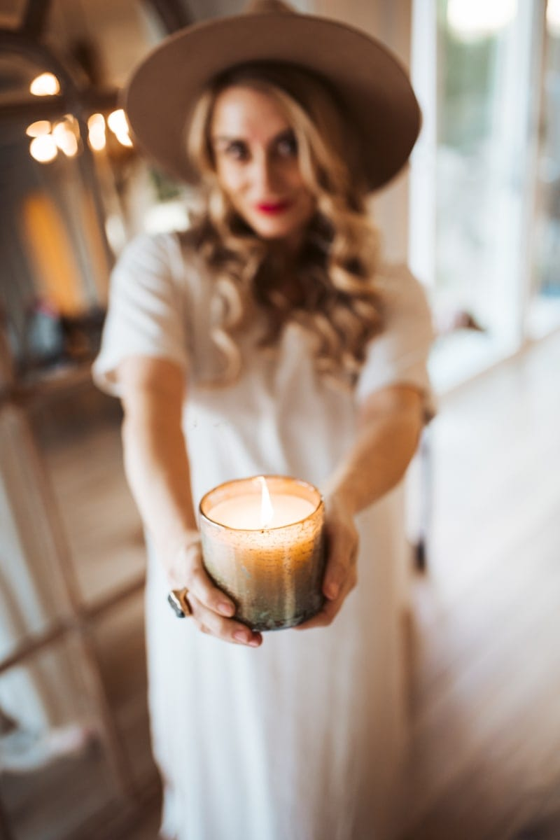 woman holding arhaus candle