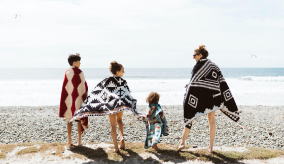 mom with kids at the beach