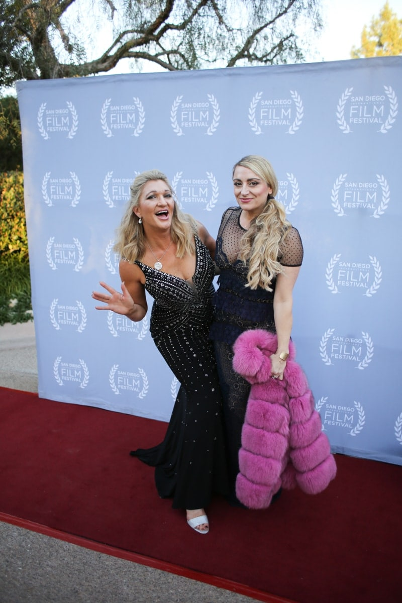 women posing on red carpet