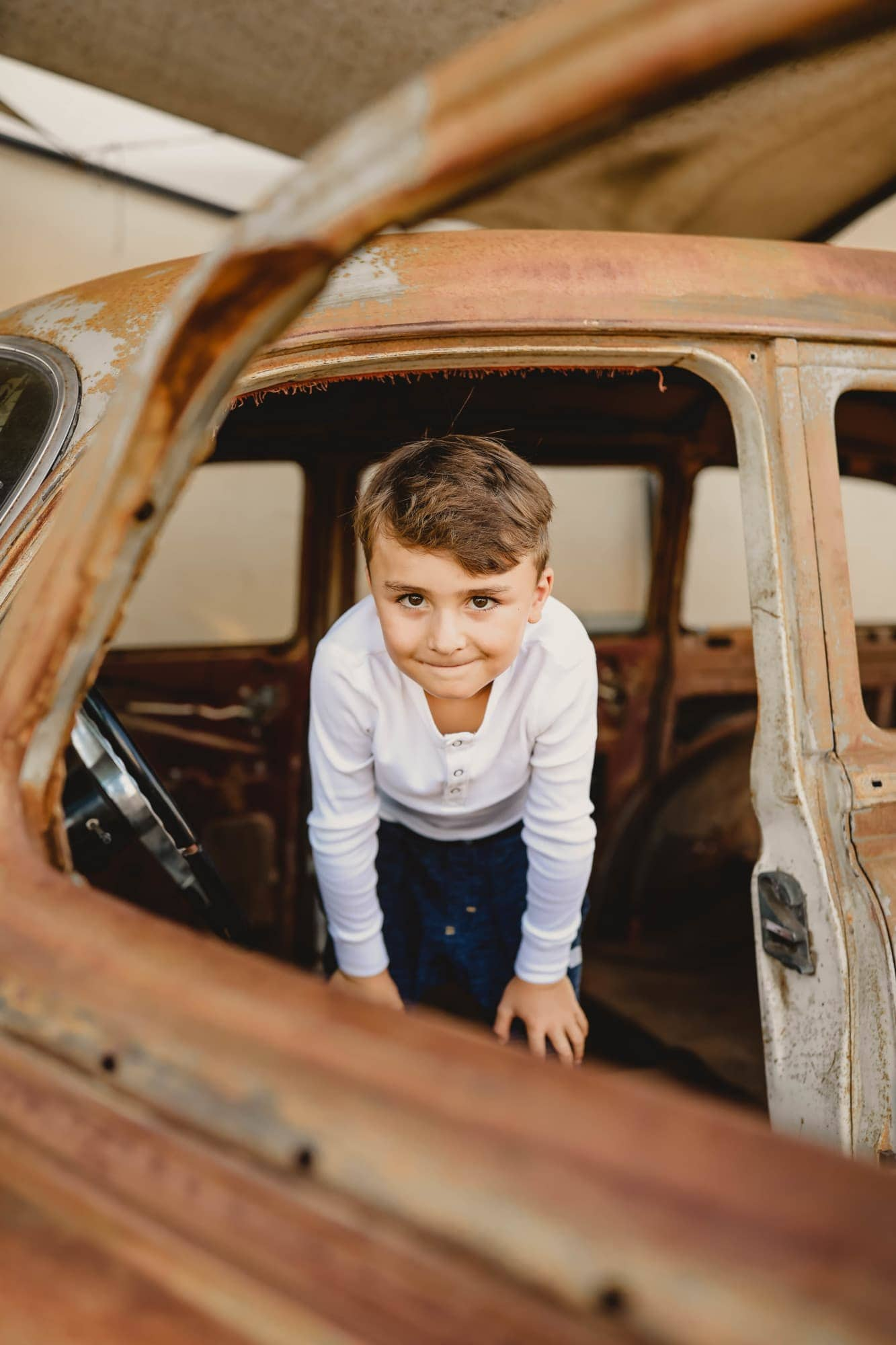 boy playing in car