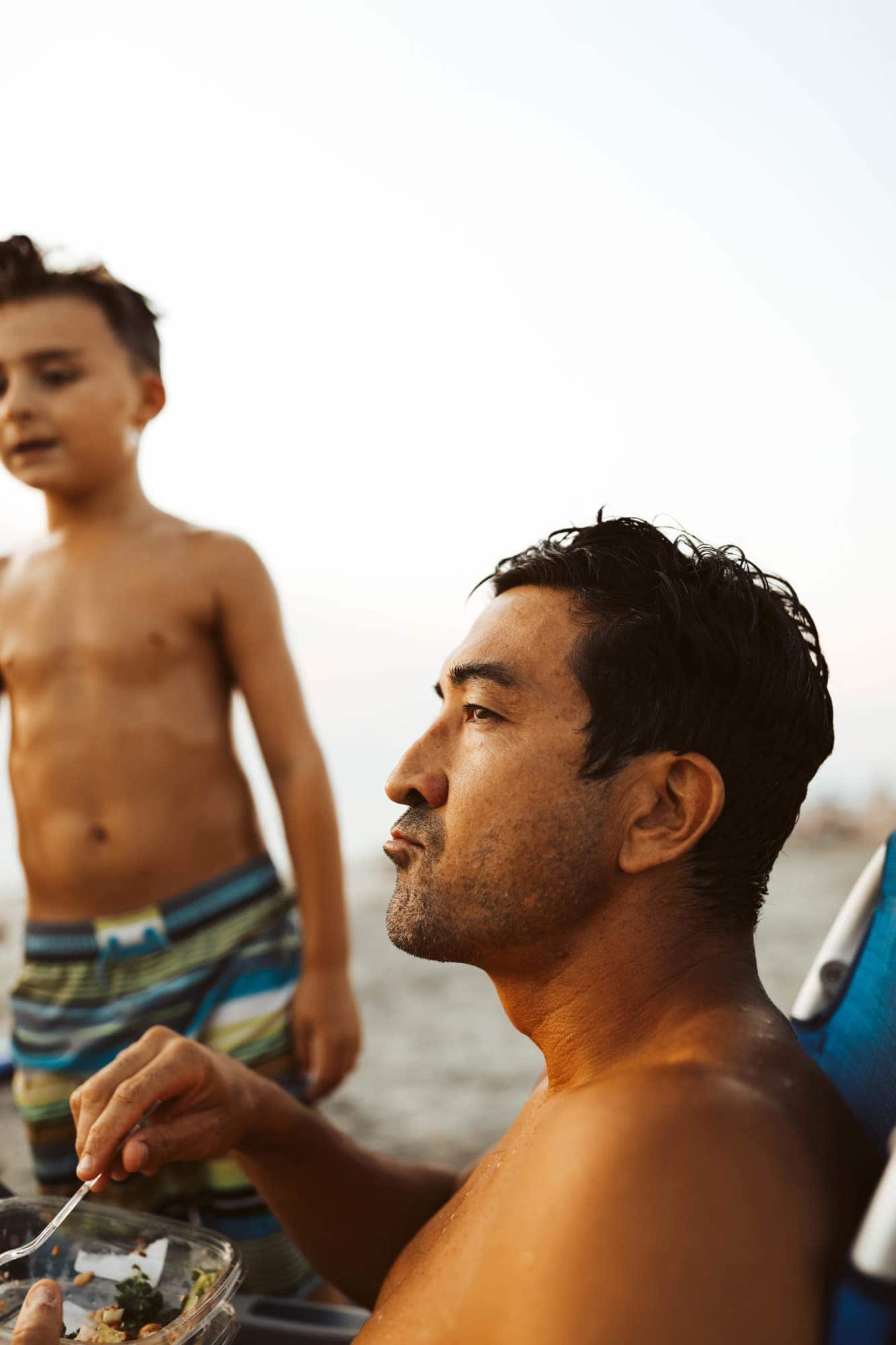 dad and child at the beach