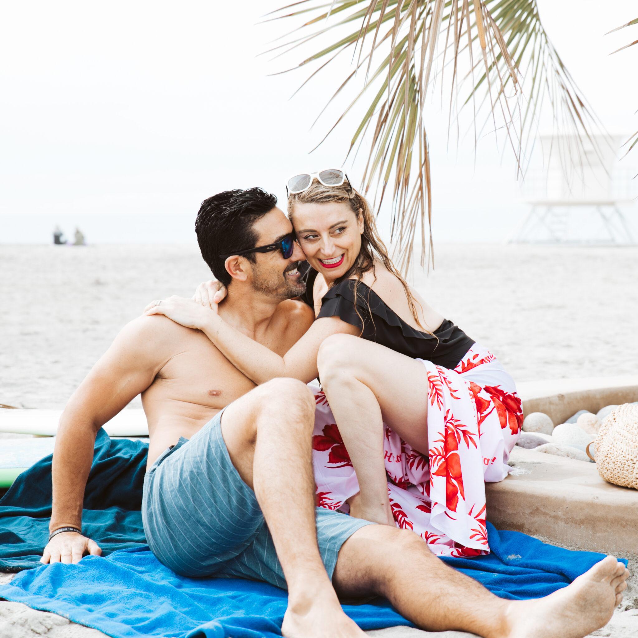 couple cuddling on the beach