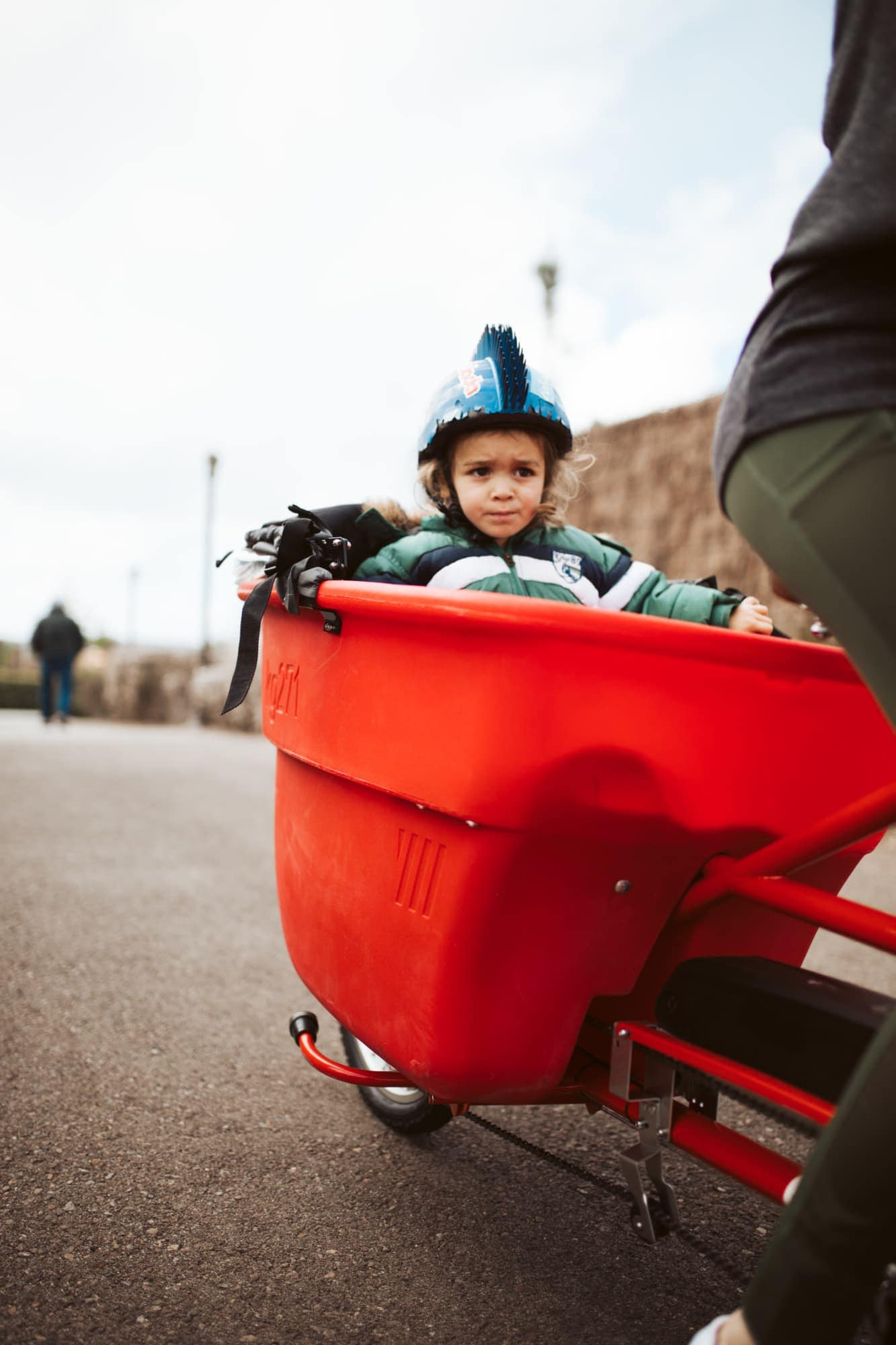 child in bucket bike