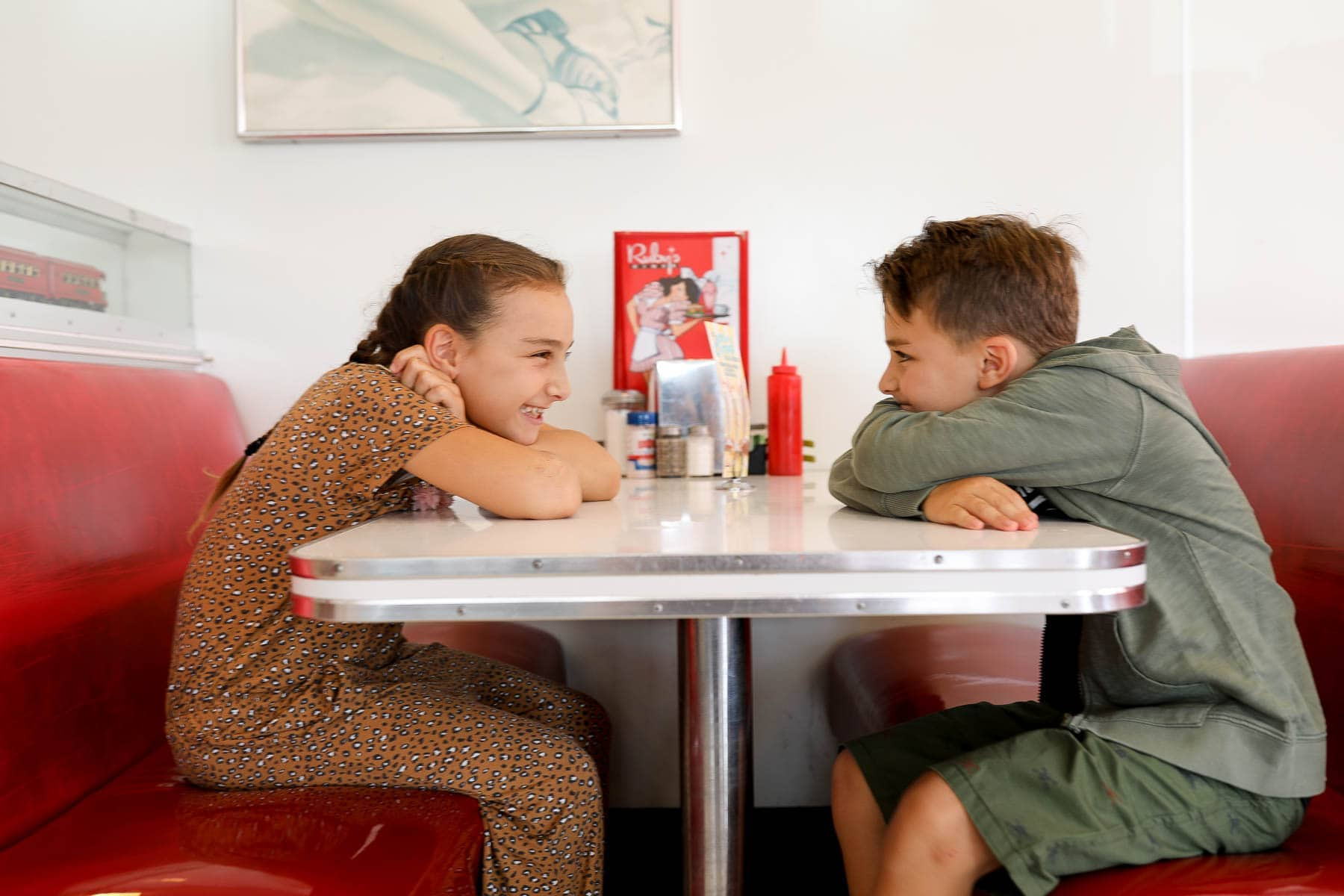 kids sitting at a diner