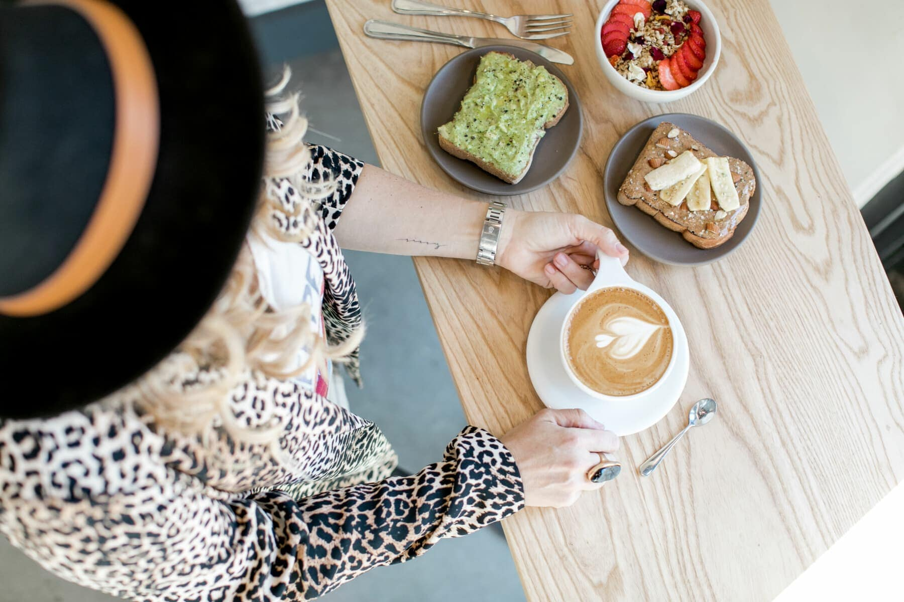 woman with coffee and avocado toast