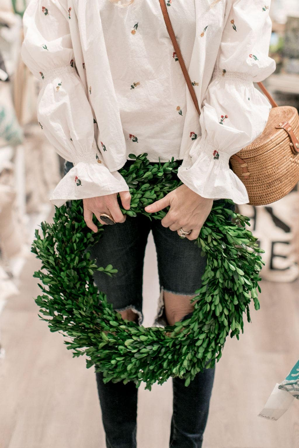 woman holding wreath