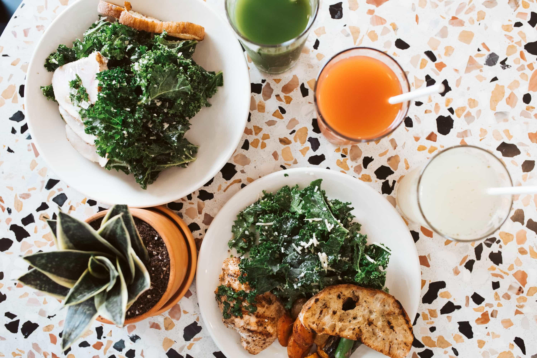 salads and drinks on table