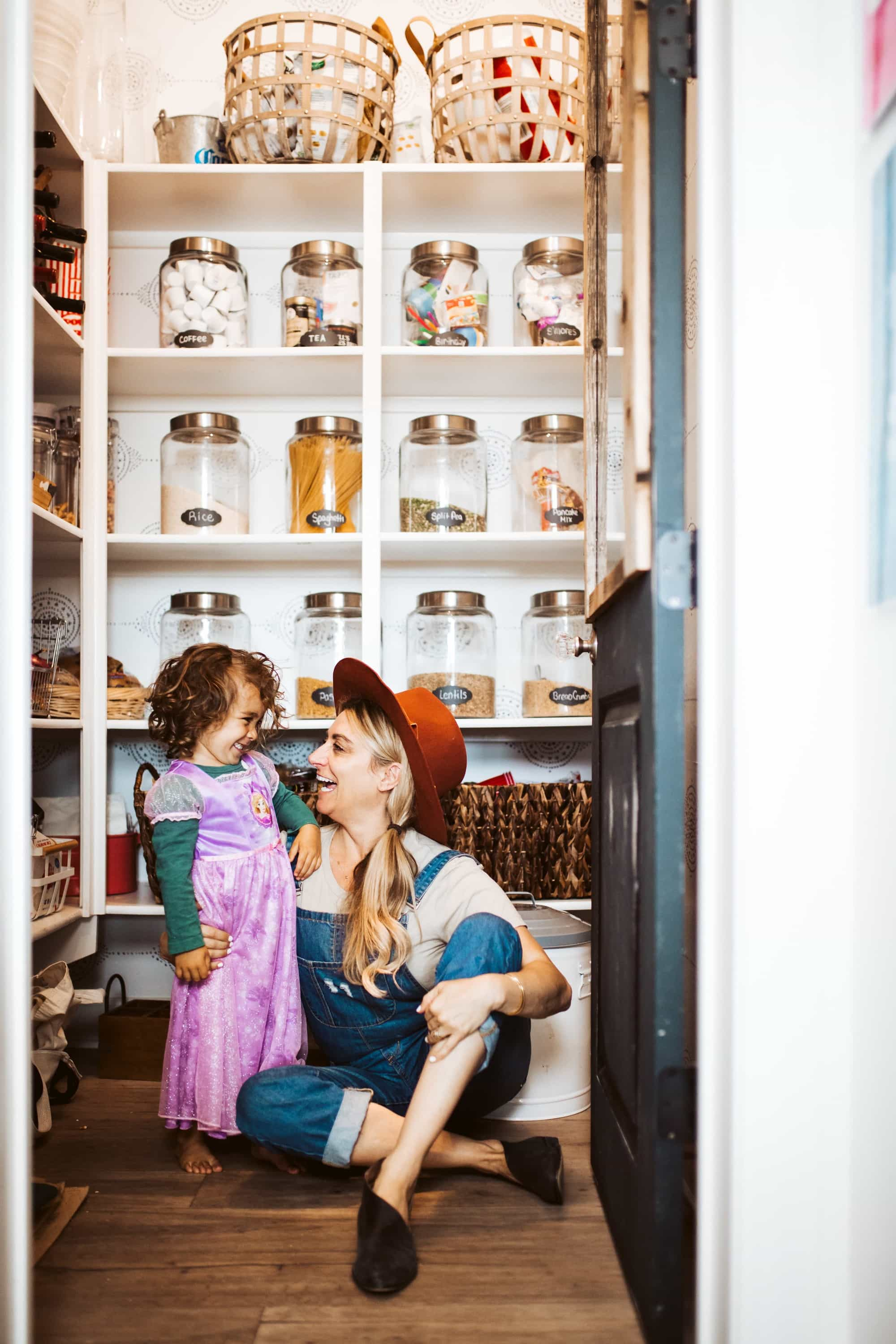 mom and son sitting in pantry