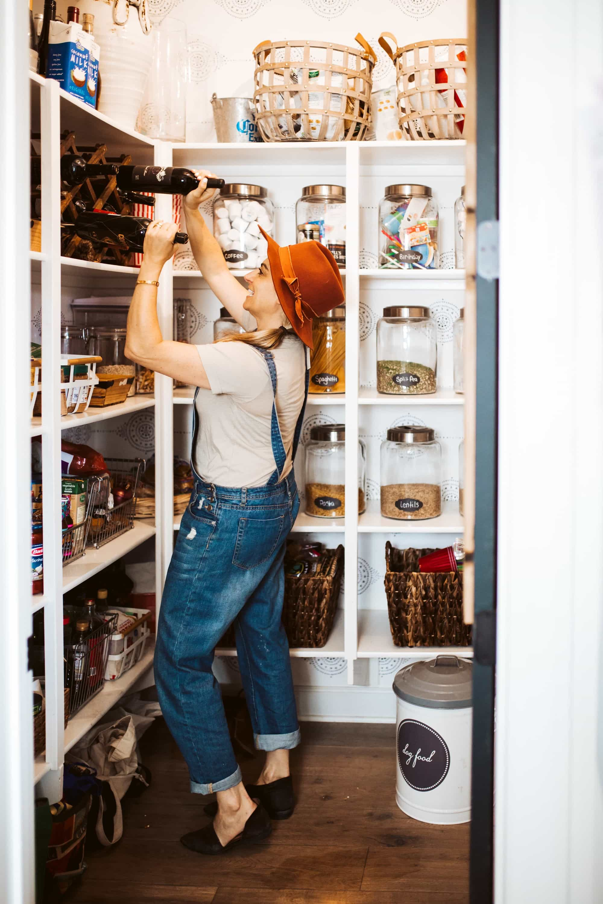 woman cleaning the pantry