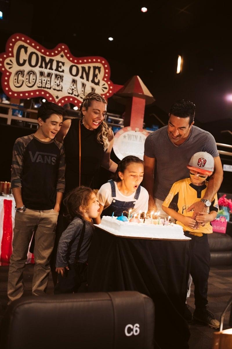 family singing happy birthday